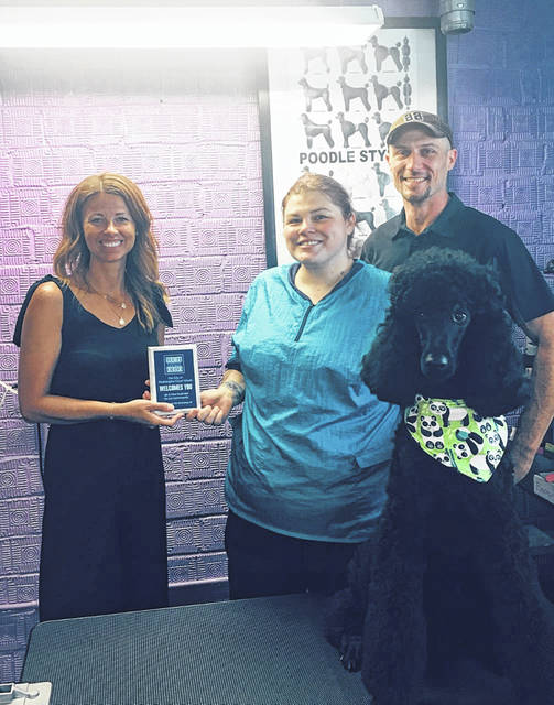 Washington C.H. City Economic Development Director Chelsie Baker recently presented a new business plaque to The Purple Poodle Pet Salon and Spa. Owned and operated by Tiffany Karn and Josh Netzley, The Purple Poodle Pet Salon and Spa is located at 222 N. Fayette St. in Washington Court House. Some of the services offered include: Tropiclean bath with a full body massage, face, paw pad and feet trim, manicures and pedicures, ear cleanings with sanitation trim, and designer cologne. Hours of operation are Monday through Friday, 9 a.m. - 5 p.m. and Saturdays, 10 a.m. - 4 p.m. Services provided to cats and dogs.