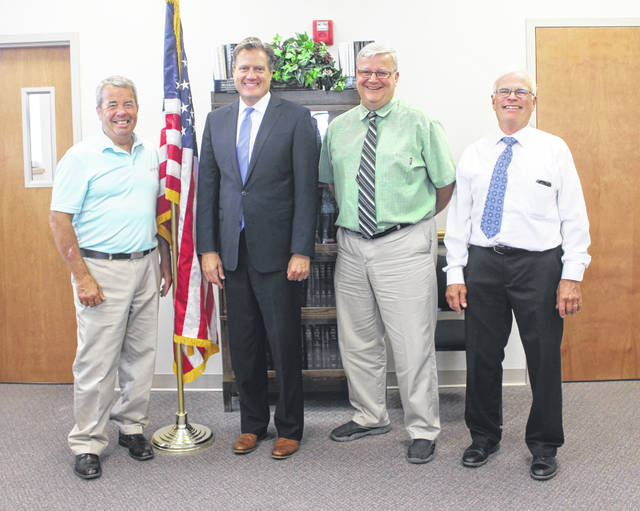 Congressman Michael Turner stopped in to see the Fayette County Commissioners on Monday to give an update on what's happening in Washington D.C. and to hear an update on how Fayette County is doing. From left to right are commissioner Tony Anderson, Turner, commissioner Dan Dean and commissioner Jim Garland.