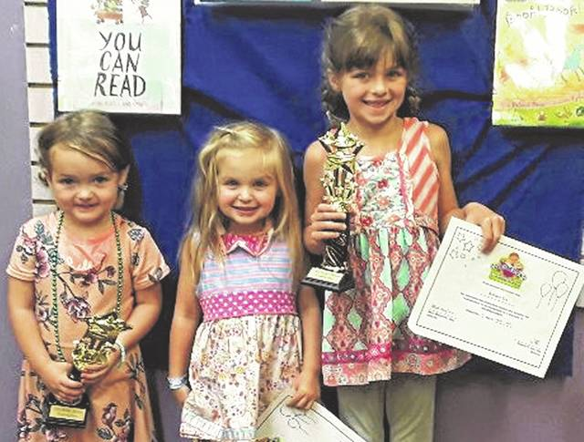 Three local families have surpassed the achievement of reading 1,000 books before Kindergarten which is the goal of a national program. Abigail Thoroman, Cali Six and Kenley Six received their certificates over the weekend. Not pictured are Emma Thoroman and Tori Schilchter.