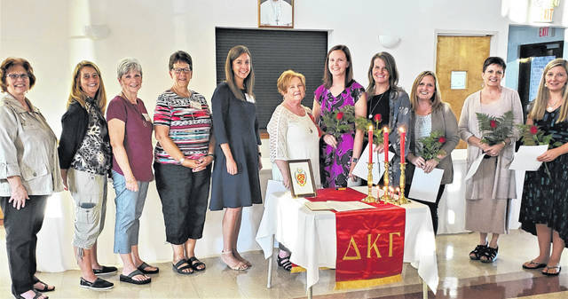 The Washington C.H. chapter of The Delta Kappa Gamma Society International initiated five new members at its September meeting, keeping it at 121 members the strongest DKG group in the entire state of Ohio. The local chapter is proud to be celebrating its 80th year of existence, having been founded in the spring of 1939 as an honorary society to promote the professional and personal growth of key women educators. Pictured in the St. Colman Parish Hall are several sponsors and committee members for Membership & Initiation on the left, with the five new members—all active teachers—on the right, the latter holding their red roses and membership certificates. The woman in the exact center is Vice President Cathy White, who presided over the meeting in the absence of President Carol Waddle. Shown are (from left) Marty Burns, Shari West, Maggie Glass, Robin Dolphin and Katie Abbott; VP Cathy White; and new members Lindsay Burns, Mallory Bihl, Valerie Hawvermale, Kim Johnson and Kristin Preston.