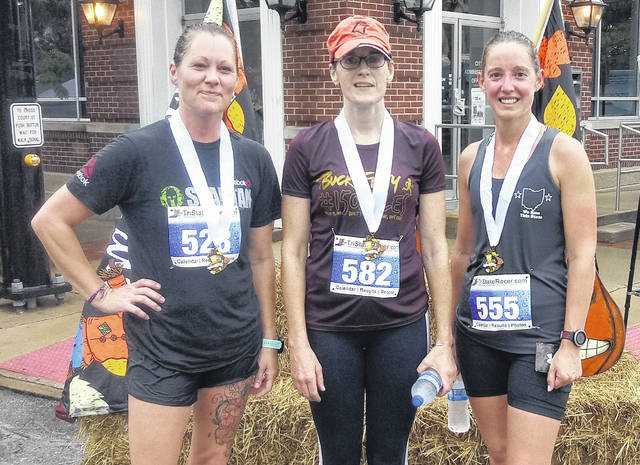 The top three female winners in the Scarecrow 5K were (L-R) Jennifer Martin in second place, Kate Teter in first place and Bridgett Shoemaker in third place.
