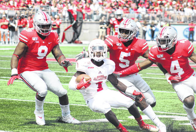 A trio of Ohio State defenders (l-r); Jashon Cornell (9), Baron Browning (5) and Jordan Fuller (4) surround Florida Atlantic's Willie Wright (1) during the first half of the season-opening game at Ohio Stadium Saturday, Aug. 31, 2019.