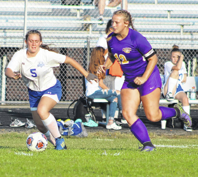 The Washington Lady Blue Lion soccer team played a Frontier Athletic Conference match at McClain High School in Greenfield Thursday, Sept. 19, 2019. Above, Washington's Abby Joseph (5) and a player from McClain go for control of the ball. McClain won the game, 11-0. Washington will be back in action Tuesday at Hillsboro at 5 p.m.