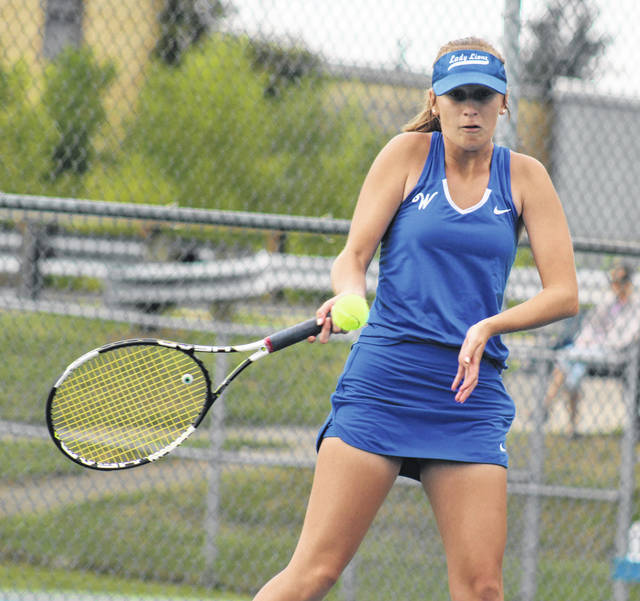 Washington's Brooklyn Foose hits the return during a first singles match against Miami Trace Tuesday, Aug. 27, 2019 at Gardner Park.