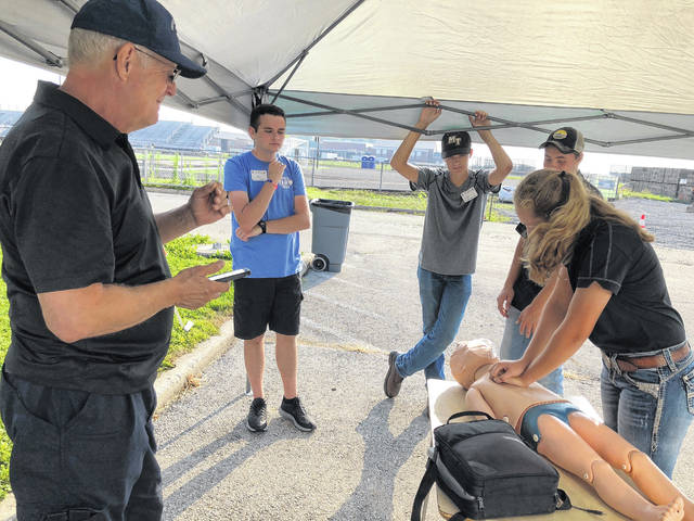 The Miami Trace/Great Oaks FFA Chapter will conduct its second-annual Cultivating Safety Day on Saturday, Sept. 21 at the Scarecrow Festival. The purpose of the Safety Day is to raise awareness about common safety issues and practices in our community. Pictured are several students taking CPR training during another Cultivating Safety Day.