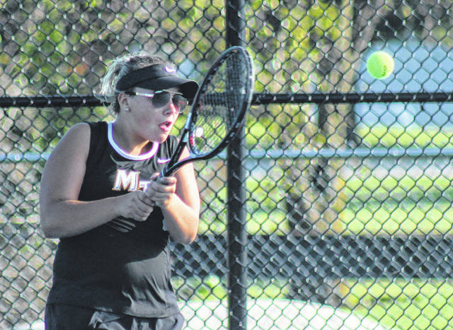 Cameron Bucher hits the return for Miami Trace in her third singles match against Clinton-Massie Wednesday, Sept. 4, 2019 at Miami Trace High School.