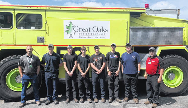 "The ""Cars for Careers"" class includes, from left to right: Jack Wessel, Miguel Barnes, Aaron Saylor, Austin Fox, Wes Cordy, Matt Roush, David Foley and Gary Bronson."