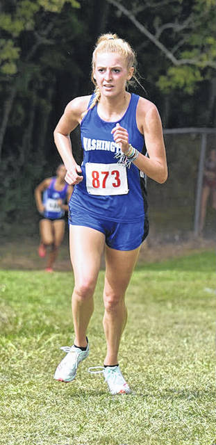 Washington's Cloe Copas leads the way in the Zane Trace Invitiational Saturday, Sept. 7, 2019. Copas won the meet in a field of 165 runners in a time of 20:32.36.