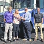 Domtar presents check to help fund 'Big Blue Bus'