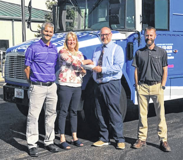 From left to right: Ryan Olaker, Domtar Rewinder & Quality Manager, Cheri Penwell, Sr. Account/Wellness Coordinator, Tom Bailey, Superintendent of WCHCS, and Jerimy Huff, Domtar Site Manager.