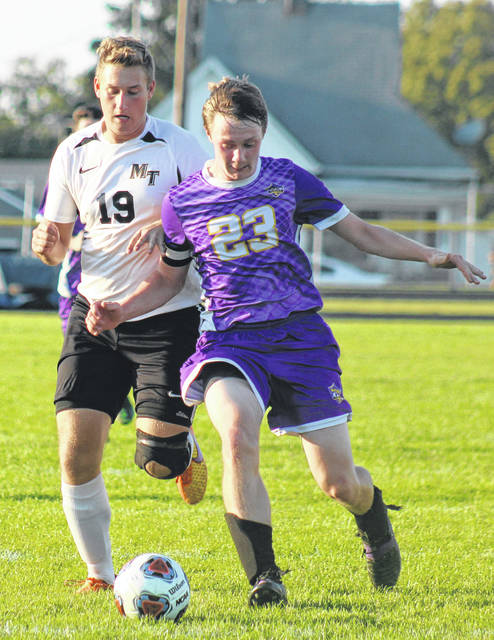 Miami Trace's Ethan Steele battles a McClain player for the ball during a Frontier Athletic Conference match at McClain High School in Greenfield Tuesday, Sept. 10, 2019.