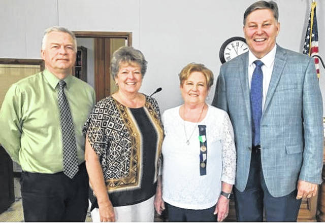 From left to right, David B. Bender, Fayette County Probate Judge; Cathy Templin, Fayette County Recorder; Cathy Massie-White, liaison for Fayette County Genealogical Society, and John deJong, multi-area manager for FamilySearch.
