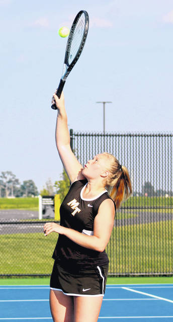 Haiven Pepper reaches up for the return for Miami Trace during a first doubles match against Unioto Wednesday, Sept. 11, 2019 at Miami Trace High School.