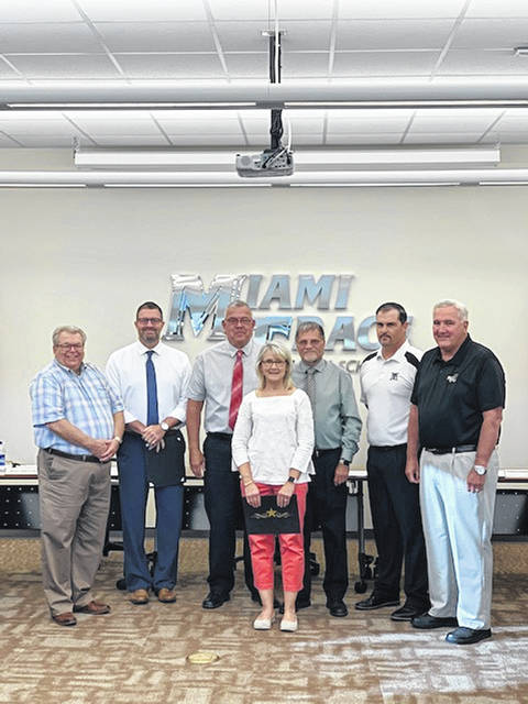 The Miami Trace School Board of Education honored several individuals on Monday evening during its regularly-scheduled meeting. Peggy Groff was honored for earning Certified EMIS Professional status.