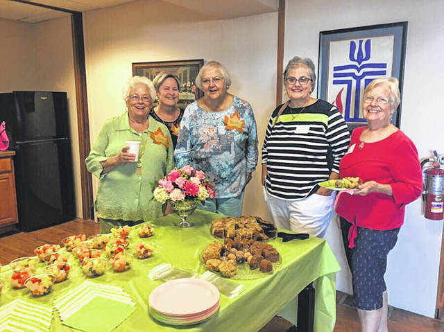 Pictured are Wilma Dorn, Polly Dean and Hannah Morris, greeting two of the women from Presbytery of Scioto Valley.
