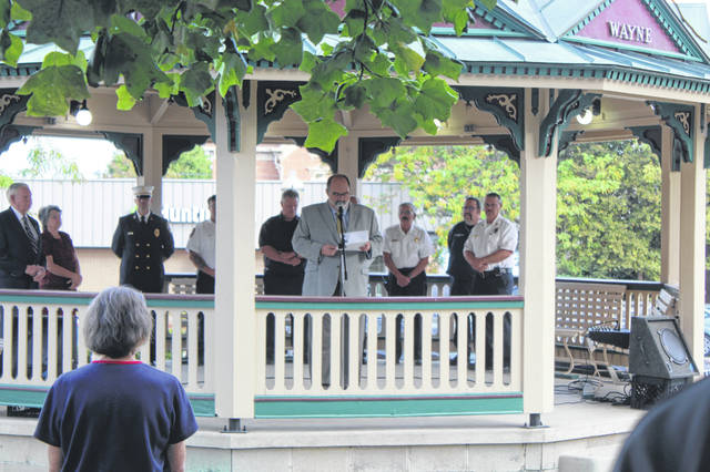 Members of the community gathered on the Courthouse lawn at the Gazebo in Washington Court House on Wednesday morning to honor the lives lost during the 9/11 terrorist attack with a brief ceremony. During the ceremony Washington Court House City Manager Joe Denen welcomed the crowd and thanked them.