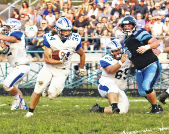 Washington's Jamie McCane (34) carries during a non-conference game at Adena High School near Frankfort Friday, Sept. 13, 2019. Also pictured for the Blue Lions is Ezekiel Watson (65).