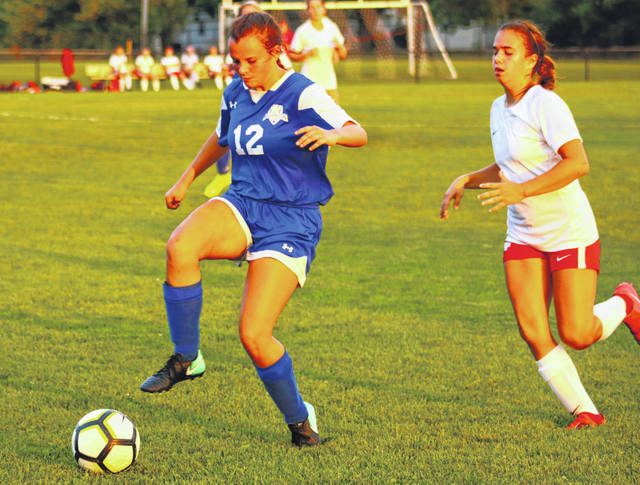 Washington's Jordan Montgomery (12) controls the ball during a Frontier Athletic Conference match against Jackson at Washington High School Thursday, Sept. 12, 2019. Jackson won the match, 13-1. Junior captain Arianna Heath scored for Washington on a direct kick. Washington will next play at Miami Trace High School Tuesday at 7 p.m.