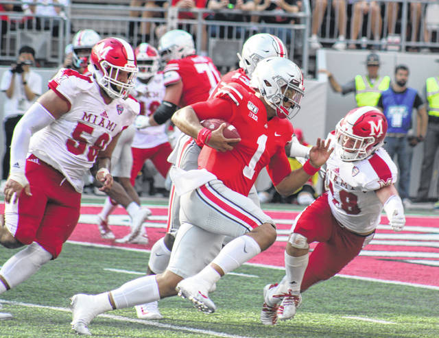 Justin Fields (1) runs for a touchdown in the first half of a game against the Miami RedHawks at Ohio Stadium Saturday, Sept. 21, 2019.