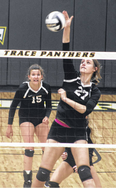 Miami Trace's Sidney Howard (27) makes the kill at the net during a Frontier Athletic Conference match against Jackson played at Miami Trace High School Thursday, Sept. 19, 2019. Also pictured for Miami Trace is Tapanga Sanderson (15).