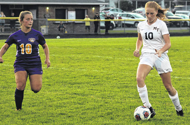 Miami Trace's Magarah Bloom (at right) brings the ball up the field during a Frontier Athletic Conference match at McClain High School in Greenfield Tuesday, Sept. 10, 2019.