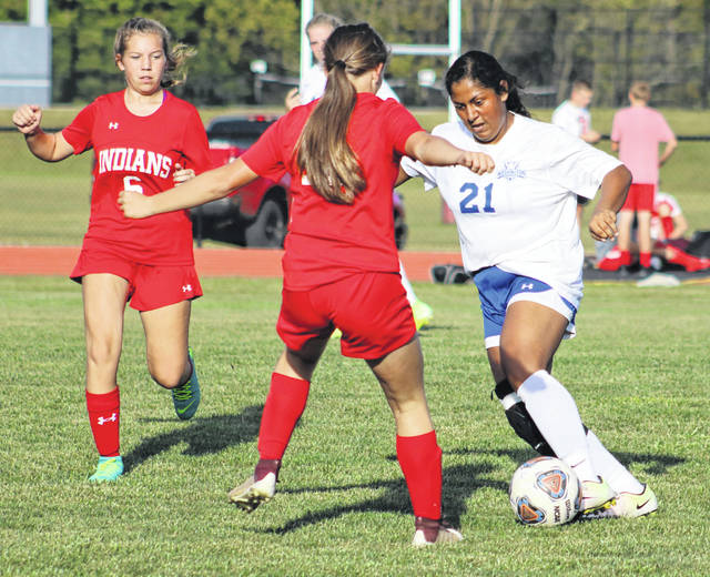 Washington's Maria Medina (21) is double-teamed during a Frontier Athletic Conference match at Hillsboro Tuesday, Sept. 24, 2019. Hillsboro won the match, 3-0. Washington will play at Jackson Tuesday, Oct. 1 at 5 p.m.
