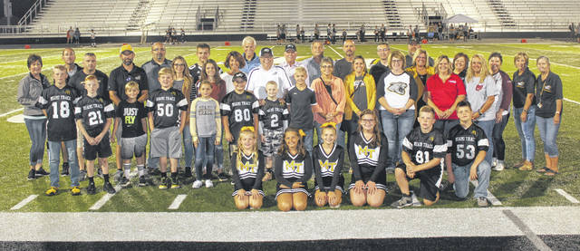 The Miami Trace Local School District thanked several of its athletic sponsors during halftime at a recent game for their financial commitment to the district and to the local student-athletes. The businesses were accompanied by youth football and cheerleader representatives that escorted them onto the field for the ceremony. Sponsors present included diamond sponsors: Tony's Welding & Fabrication and Quali-Tee Design; gold sponsors: Fayette County Memorial Hospital, GL Pettit LLC, Miami Trace Athletic Boosters and Pepsi; silver sponsors: Fayette Veterinary Hospital, Kirk's Furniture, Valero and Vermeer; bronze sponsors: Melvin Stone and WCR; and education sponsor Southern State Community College. Sponsors not present were: gold sponsors: Baxla Tractor and First State Bank; silver sponsors: KBP Foods and Parrett Insurance; and bronze sponsors: Doug Marine Motors, Hartley Oil, Herron Financial Group and M&M Fasteners.