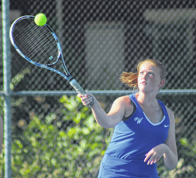 Washington's Sydnie Hall keeps her eyes on the ball during a first doubles match against Unioto Tuesday, Sept. 17, 2019 at Gardner Park.