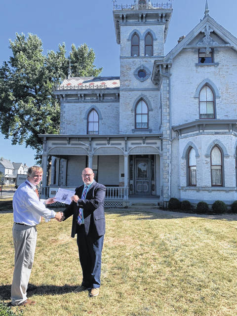 The Washington Court House City School District is proud to partner with the Fayette County Historical Society, where the history of the past meets that of the future. Washington City Schools Superintendent Tom Bailey (right) purchases a 2020 historical calendar from James A. Carr.