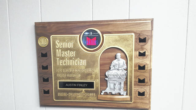 The plaque for Austin Finley's Senior Master Technician award.