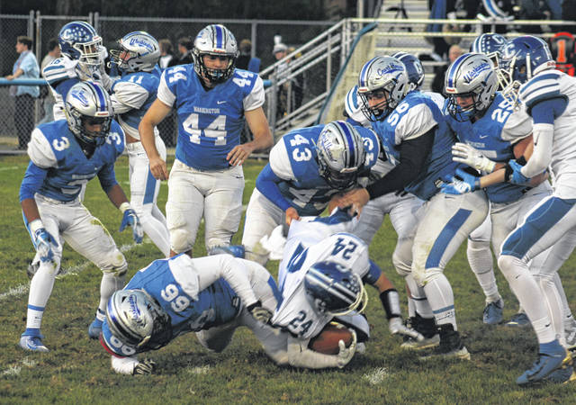 Several members of the Washington Blue Lion defense surround the Chillicothe ball-carrier during the Frontier Athletic Conference opener Friday, Oct. 4, 2019 at Gardner Park. Pictured for Washington (l-r); Trevaughn Jackson (3), Garitt Leisure (11), Cassius Howland (66), Alex Hamrick (44), Brandon Cubbage (43), Mason Mustain (56) and Collier Brown (25).