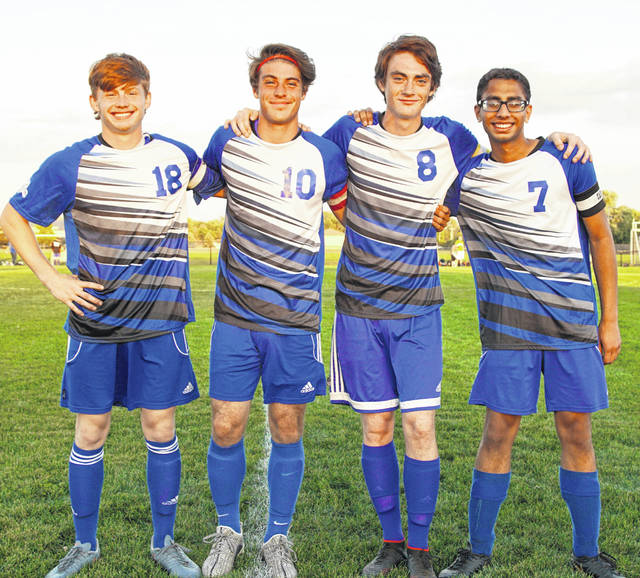 Washington Blue Lion soccer seniors were recognized prior to the match against Miami Trace Thursday, Oct. 3, 2019. (l-r); James Baughn, Grant Kuhlwein, Samuel Schroeder and Shlok Shah. Washington will host New Lexington in a Sectional tournament game Monday at 5 p.m.