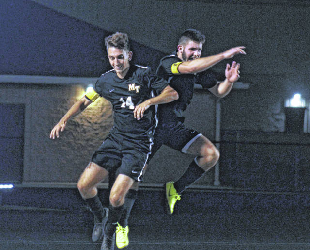 Miami Trace's Caleb Perry (left) and Kyler Conn celebrate a goal during a Frontier Athletic Conference victory over the Hillsboro Indians Tuesday, Oct. 1, 2019.