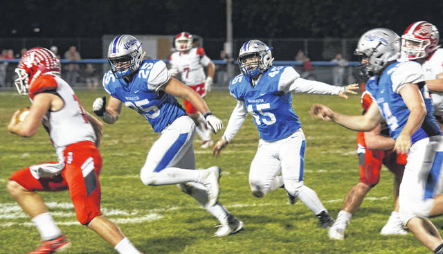 Washington Blue Lion defenders (l-r); Collier Brown (25), Chase Sluder (45) and Alex Hamrick (44) pursue the Jackson ballcarrier during a Frontier Athletic Conference game at Gardner Park Friday, Oct. 11, 2019.