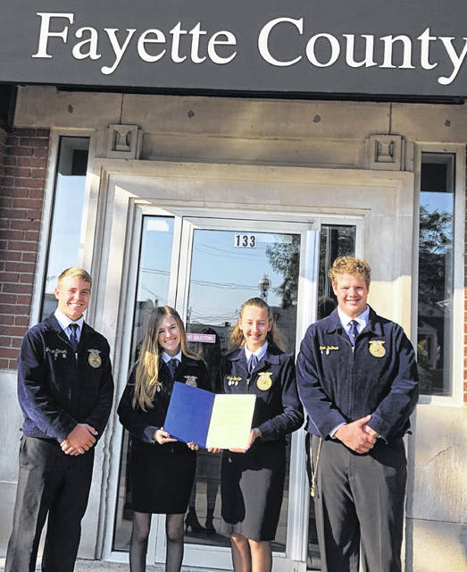 FFA members Graham Carson, Lydia Zwoll, Lahni Stachler and Grant DeBruin visited the Fayette County Commissioners' office on Monday to receive a proclamation.