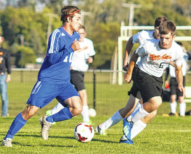 Washington's Grant Kuhlwein (at left) advances the ball during a Division II Sectional match against New Lexington Monday, Oct. 14, 2019 at Washington High School. Kuhlwein scored both goals in a 2-1 Washington victory. The Blue Lions will play at Miami Trace Thursday at 5 p.m.