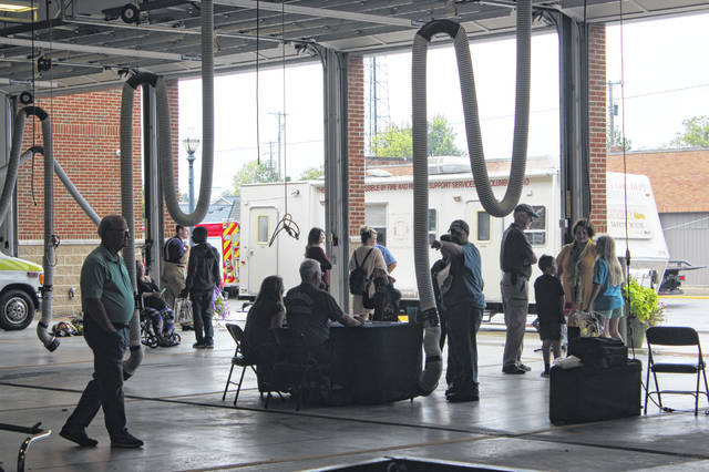 The Washington Fire Department held its annual Open House on Sunday afternoon. Several residents stepped into the building while a drizzle of rain fell outside. The rain didn't last long and soon kids and parents were back to enjoying the attractions.