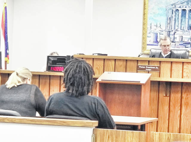 Jamie Jones (right), seated next to his attorney, was sentenced by Washington Municipal Court Judge Victor Pontious Thursday morning in a dog neglect case.