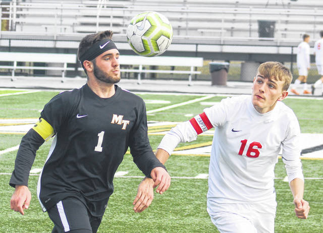 Miami Trace's Kyler Conn (1) looks to settle the ball during a Division II Sectional finals match against Jackson Saturday, Oct. 19, 2019. Pictured for Jackson is Taylor Frazier (16).