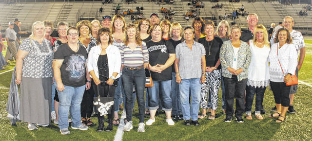 Members of the Miami Trace High School class of 1979, above, was recognized at halftime of the football game against Western Brown Friday, Sept. 27, 2019.