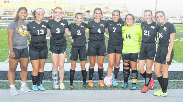 Miami Trace Lady Panther soccer seniors were recognized after a 1-0 win over Hillsboro Tuesday, Oct. 1, 2019. (l-r); Shania Villarel, Alayna Huddleson, Isabella Vanover, Emily Powell, Jenna Griffith, Morgan Eggleton, Aubrey Schwartz, Addie Campbell and Charlotte Jacobs.