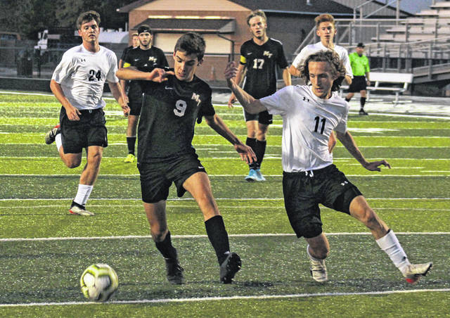Miguel Iturriagagoitia Azagra (9) of Miami Trace is about to shoot and score a goal during a non-conference game against Lynchburg-Clay Tuesday, Oct. 8, 2019 at Miami Trace High School. Also pictured for Miami Trace are (in back, l-r); Kyler Conn and Kody Burns.