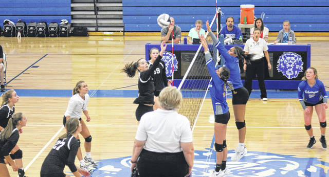 Miami Trace and Washington battled for at least a share of the Frontier Athletic Conference championship Thursday, Oct. 3, 2019 at Washington High School. Above, Kate Leach (at left) hits the ball for Miami Trace. Pictured at right for Washington are (l-r); Emily Semler, Rayana Burns and Halli Wall. At left for Miami Trace (l-r); Olivia Fliehman, Gracey Ferguson, Sidney Howard, Chloe Scott, Leach and Laura Robinson.