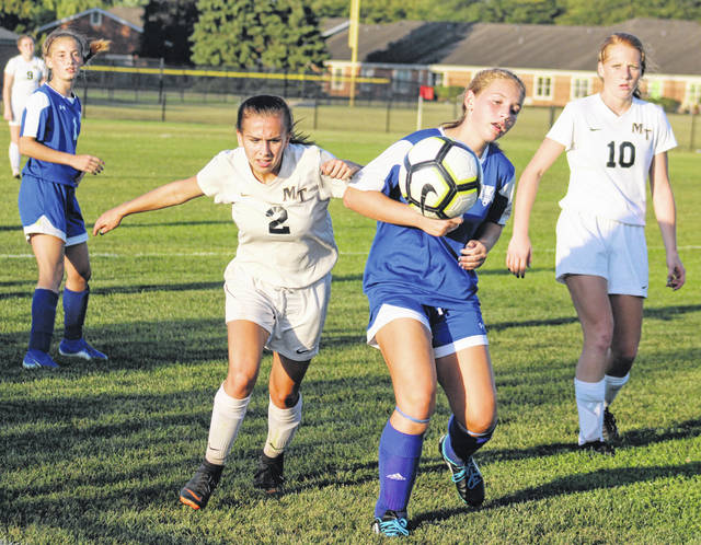 Miami Trace's Emily Powell (2) and Washington's Kalynn Dato battle for possession during a Frontier Athletic Conference match at Washington High School Thursday, Oct. 3, 2019. Also pictured, at left, for Washington, Chloe Lovett and, at right, Magarah Bloom of Miami Trace.