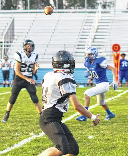 Miami Trace 8th grade quarterback Austin Boedeker (28) throws a pass to Asher LeBeau during a game at Gardner Park against the Blue Lions on Sept. 25, 2019. Pictured for the Blue Lions, at right, is Coleden May. Washington won the 7th grade game, 28-26 and Miami Trace won the 8th grade game, 34-20.