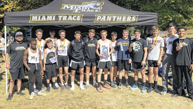 The Miami Trace Panthers cross country team after winning the Xenia Legacy Christian cross country meet Saturday, Oct. 5, 2019. (l-r); Head Coach Jeff Smallwood, Charles Lapasky, Simon DeBruin, Marcus Jackson, Jadon Rowe, Henry DeBruin, Connor Bucher, Wesley May, Matthew Warner, Max Trimble, Graham Carson, Mcale Callahan, Bo Little, Fletcher Havens and Caleb Brannigan.