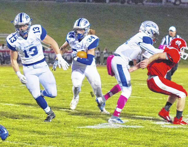 Washington's Jameson McCane (34) carries during a Frontier Athletic Conference game at Hillsboro Friday, Oct. 18, 2019. Also pictured for Washington, running interference, is Drew Moats (13).