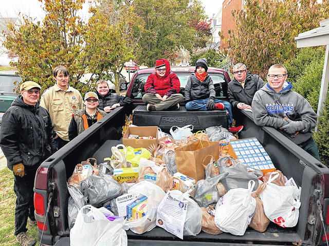 Troop 112 collected over 500 pounds of food for the local food pantry. Shown are (l-r:) Larry Bishop, Charlie Rutherford, James Smith IV, Caleb Wilt, Will White, James Thornhill, Scoutmaster Chad White, Joey Pickelheimer.