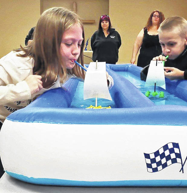 Cailin Johnson competes against Todd Thornhill during the Pack 112 Raingutter Regatta.