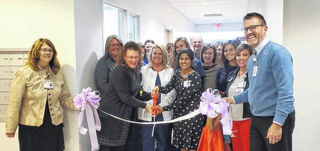 Lisa Carlson, Adena Health System CFO (left) and FCMH CEO Mike Diener (right) hold the ribbon while (from left) Beth Harper, Clinic Director, Janey Wilson RN, and Oncologist Dr. Shylaja Mani have the honor of cutting the ribbon to signify the grand opening of the FCMH Cancer Care Clinic.